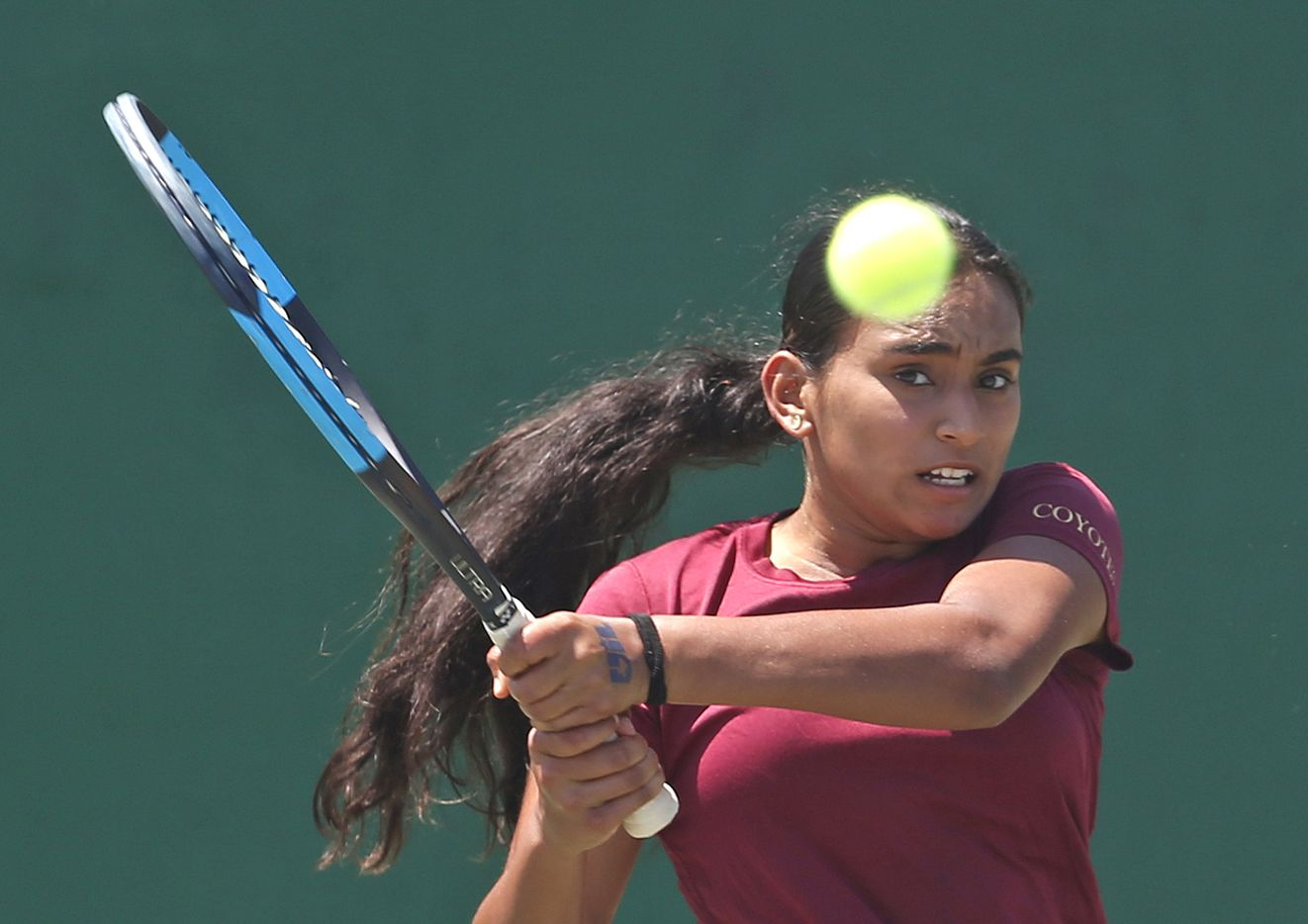 Sriya Leesha Gourammagari, of Frisco Heritage, returns a serve in a 5A girls singles match. UIL state tennis semifinals at Northside ISD Tennis Center on Thursday, May 20, 2021.