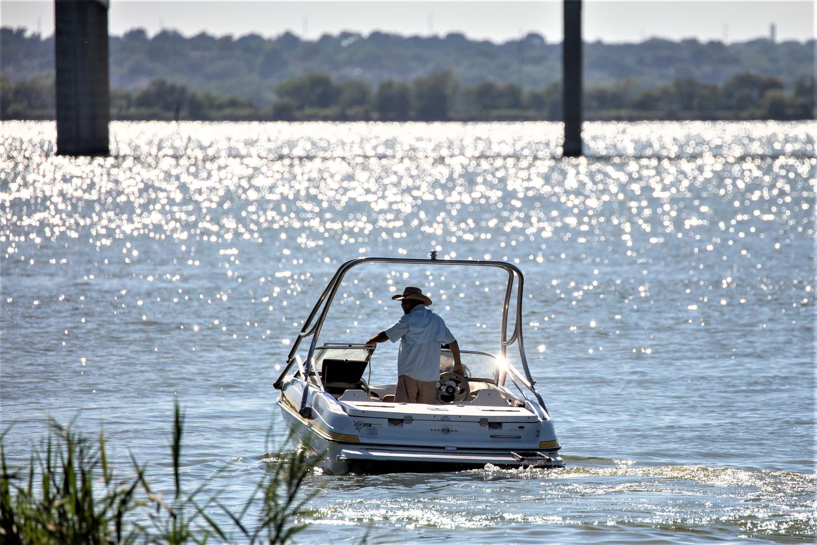 The U.S. Army Corps of Engineers oversees Lake Ray Roberts (where a boater is shown last July) and others in the area like lakes Lavon and Benbrook. They corps allows swimming in them, except in areas considered dangerous.