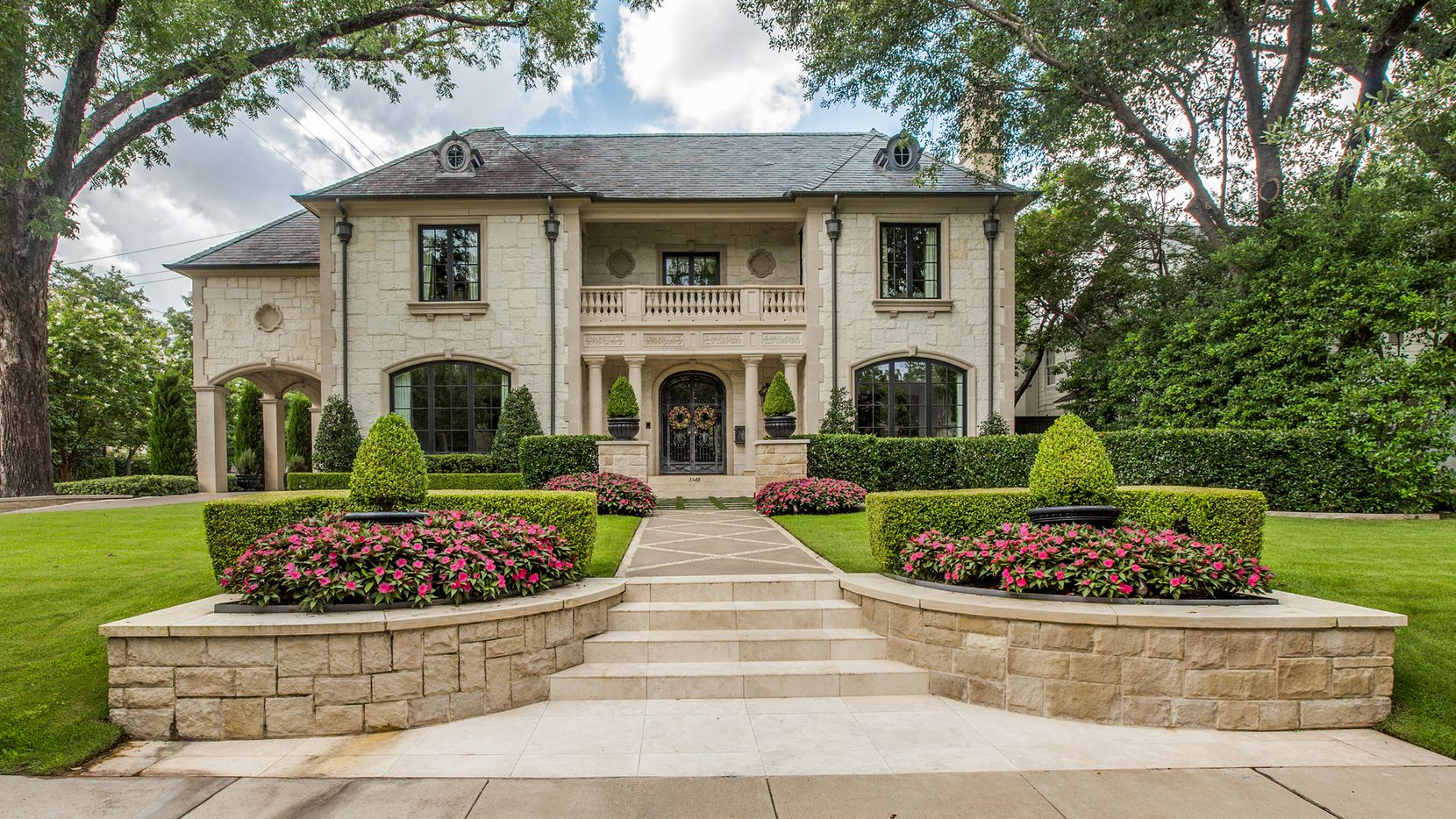 The French manor-style home at 3548 Bryn Mawr Drive has an outdoor entertaining space beside the pool.