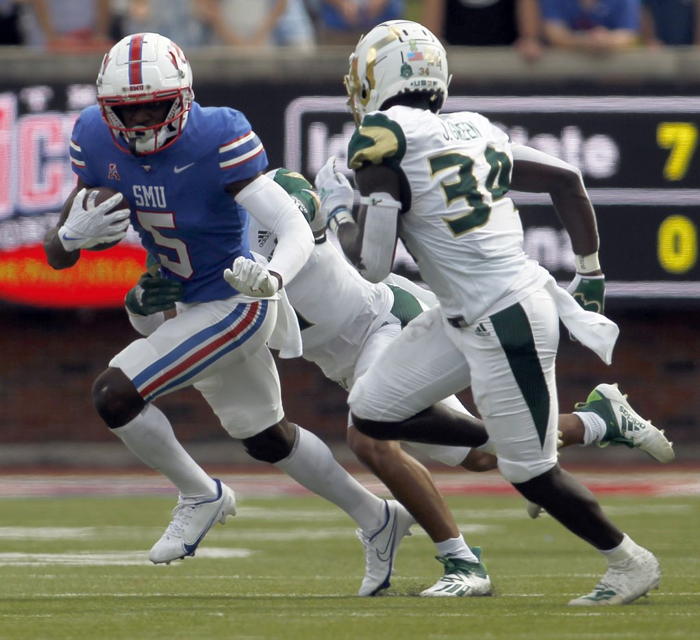SMU receiver Danny Gray (5) tacks on yards after the catch as South Florida cornerback Joshua Green (34) pursues defensively during 2nd quarter action. The two teams played their NCAA football game at SMU's Ford Stadium in Dallas on October 2, 2021. (Steve Hamm/ Special Contributor)