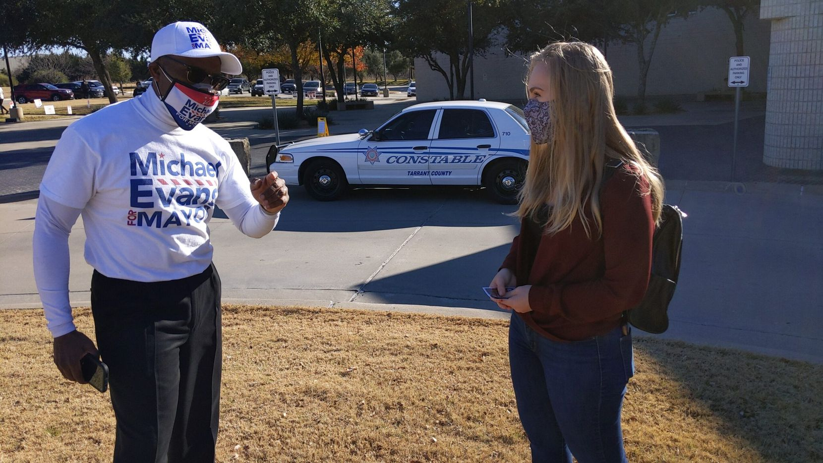 Michael Evans speaks to Mansfield voter Courtney Hester at the Tarrant County Sub-Courthouse on Tuesday, Dec. 8, 2020, the day he was elected mayor in a runoff election.
