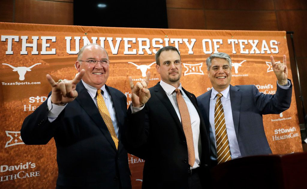 Tom Herman, center, poses with athletic director Mike Perrin, left, and school president Gregory Fenves, right, during a news conference where he was introduced at Texas' new head NCAA college football coach, Sunday, Nov. 27, 2016, in Austin. (AP Photo/Eric Gay)