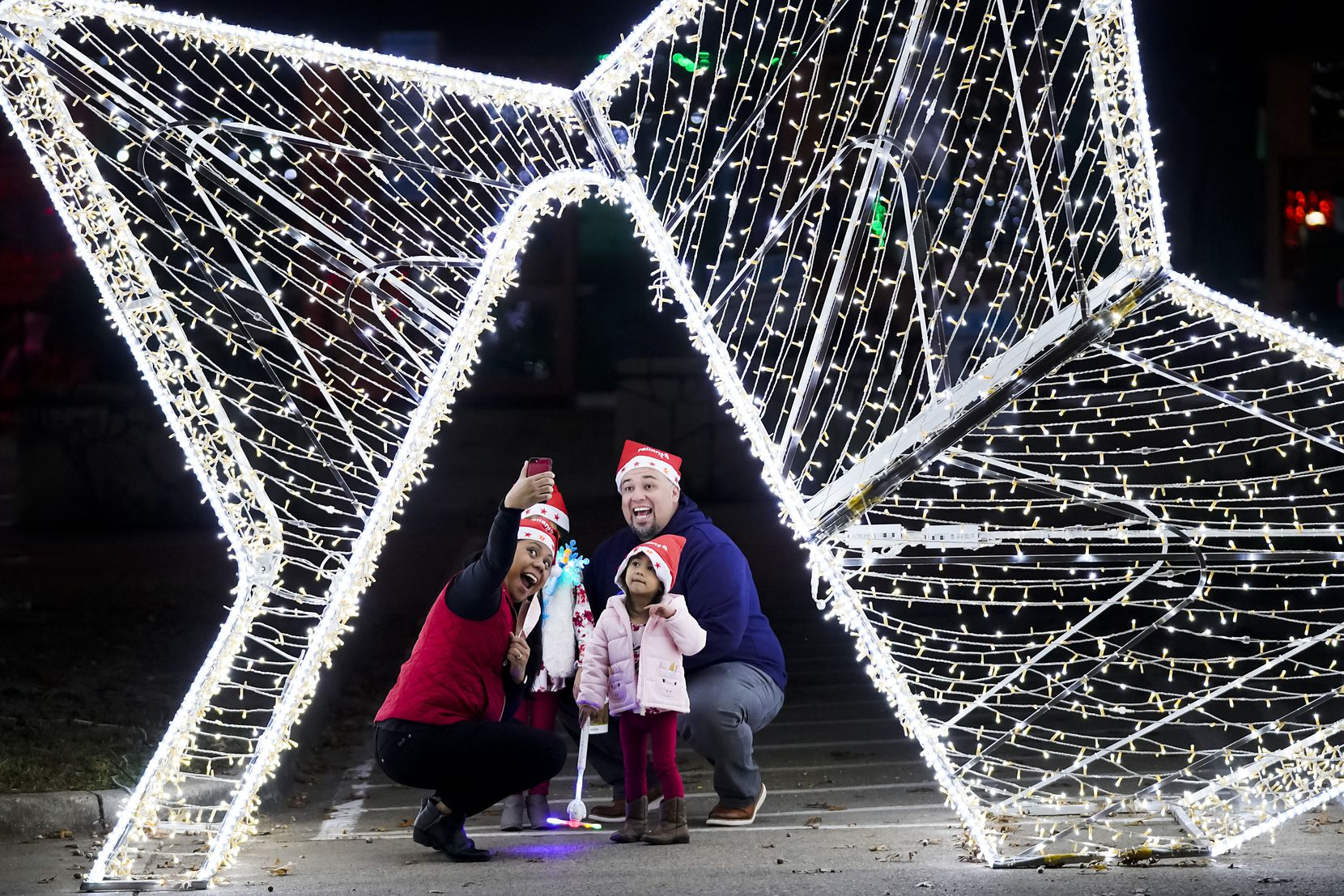 Erica Gonzalez takes a selfie with her husband Sergio and daughters Gianna, 4, and 