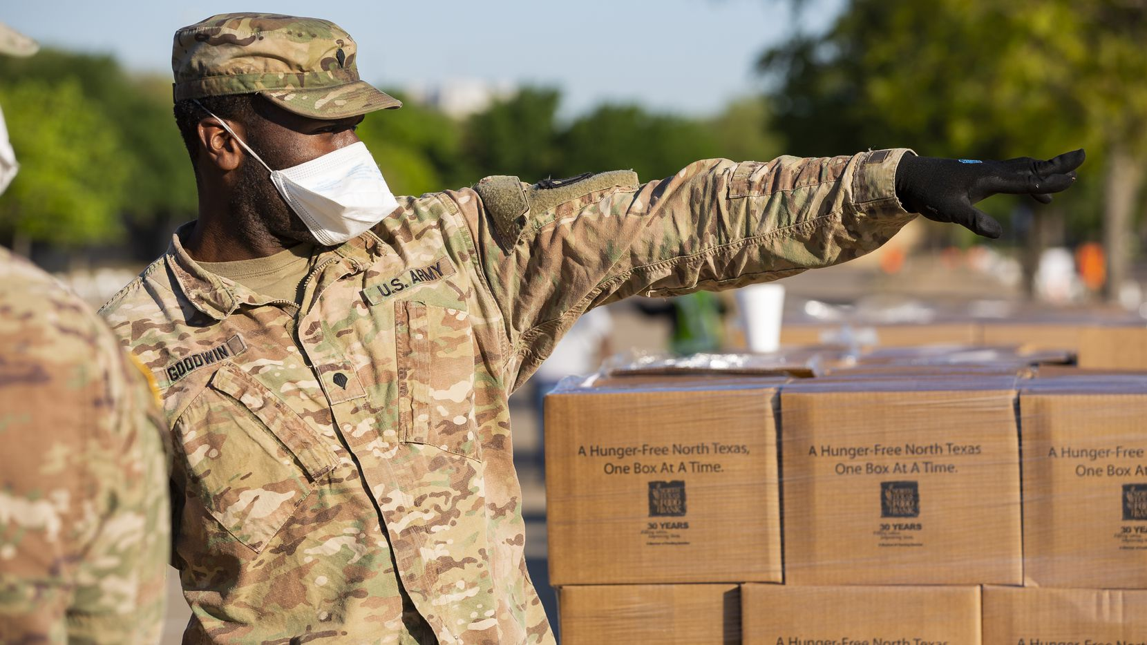 The Texas National Guard helps the North Texas Food Bank distribute free food at Fair Park on April 16, 2020 in Dallas. (Juan Figueroa/ The Dallas Morning News)
