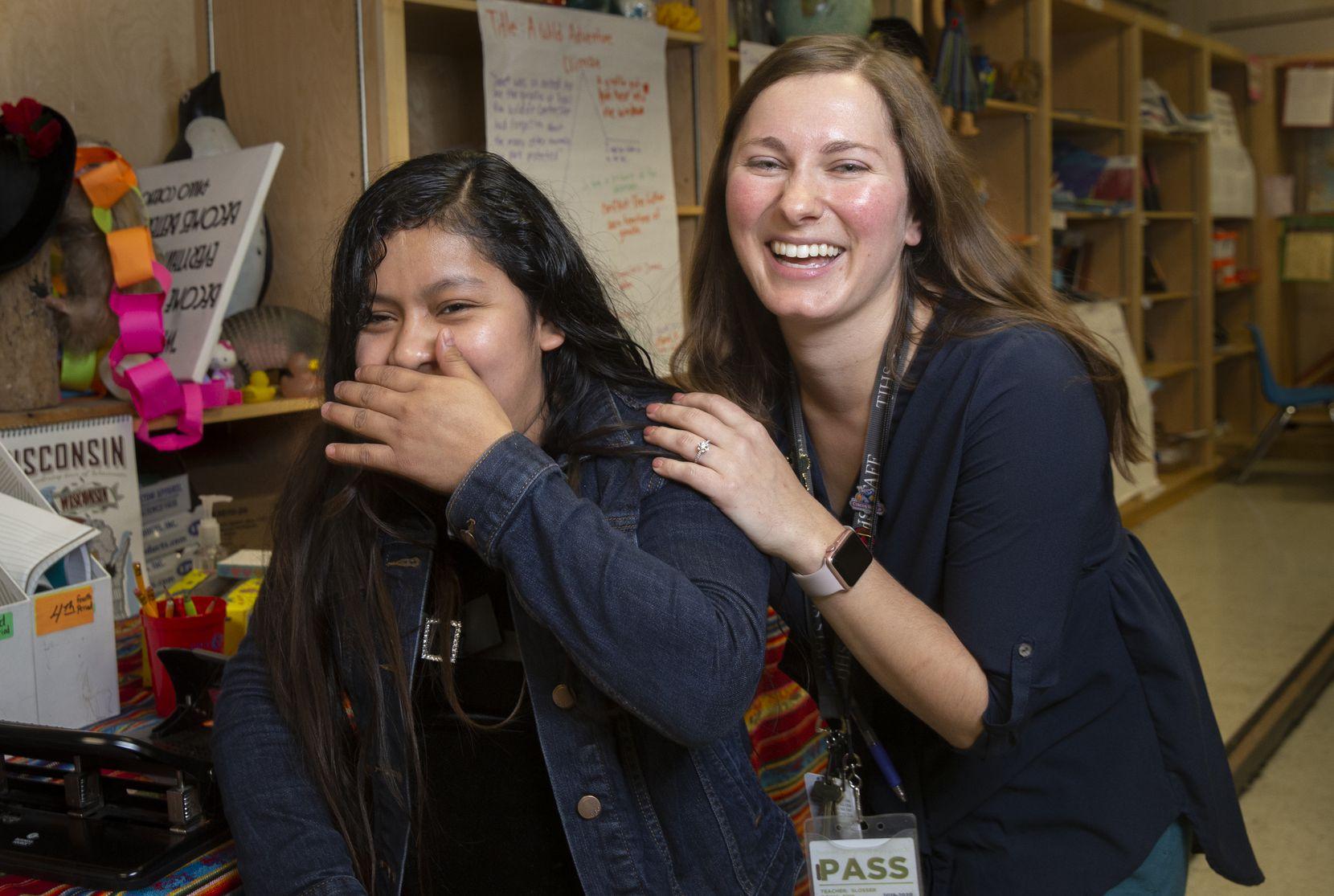 Freshman Silvia Rey (left) and ESL teacher Autumn Slosser share a laugh at Thomas Jefferson High School.