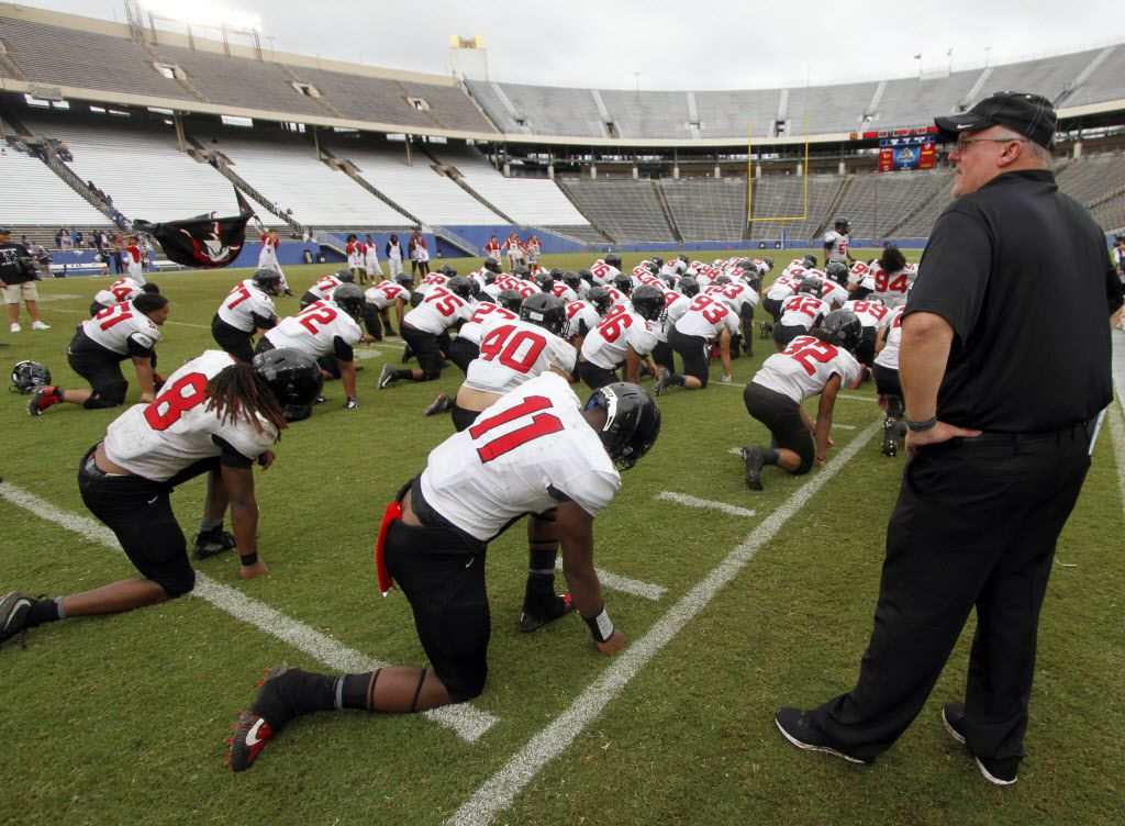 Euless Trinity head coach Chris Jensen watches as his team goes through the movements of a haka dance following their 20-14 victory over Sachse. The two teams played their non-district  football game at the Cotton Bowl in Dallas on September 8, 2018. (Steve Hamm/ Special Contributor)