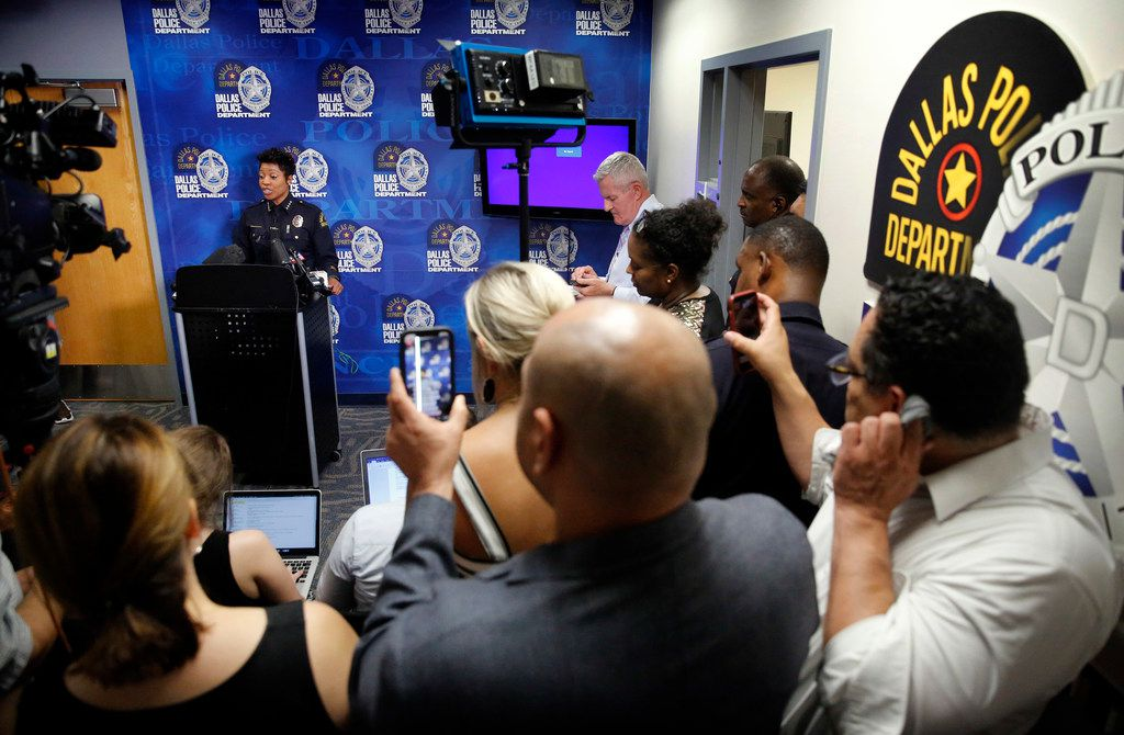 Deputy Mayor Pro Tem Adam Medrano (center, back to camera) and council member Omar Narvaez (right, front) record and stream Dallas Police Chief U. Renee Hall's press conference pertaining to the death of Chynal Lindsey, a black transgender woman found dead this weekend at White Rock Lake in Dallas. The press conference was at police headquarters Monday.