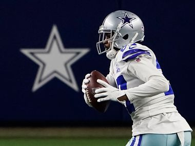 Cowboys cornerback Trevon Diggs (27) intercepts a pass during the fourth quarter of a game against the Eagles at AT&T Stadium on Sunday, Dec. 27, 2020, in Arlington.