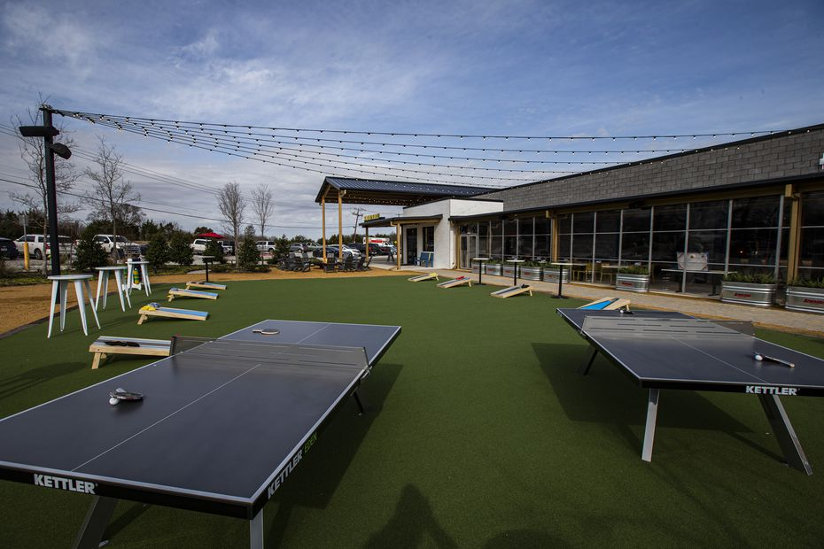Most of the outdoor area is turfed and filled with bar games like cornhole and pingpong.