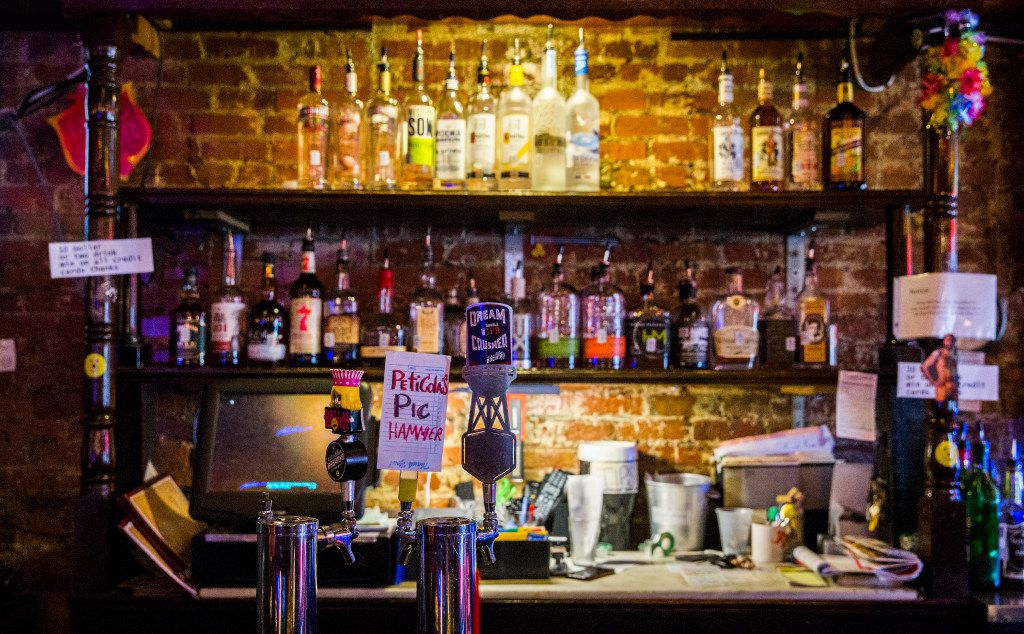 Beer taps and bottles behind the bar at The Elbow Room (Ashley Landis/The Dallas Morning News)