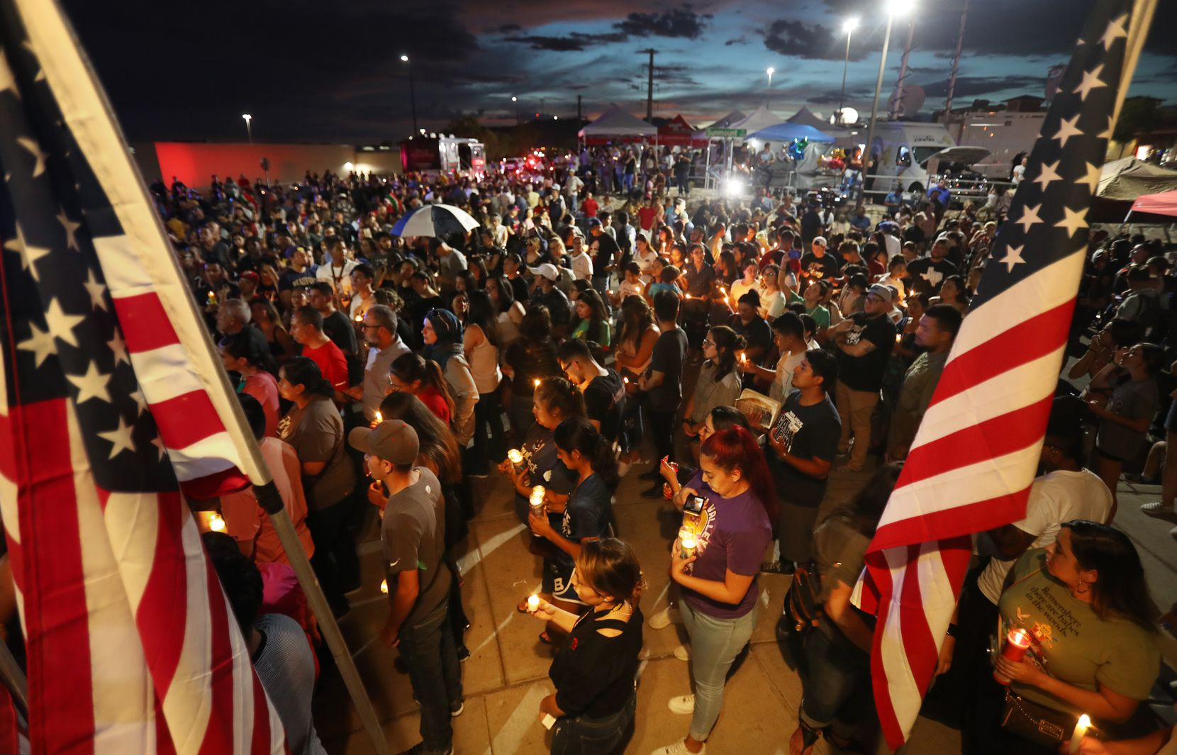 EL PASO, TEXAS - AUGUST 07: People attend a candlelight vigil at a makeshift memorial honoring victims of a mass shooting which left at least 22 people dead, on August 7, 2019 in El Paso, Texas. President Donald Trump visited the city earlier today. A 21-year-old white male suspect remains in custody in El Paso which sits along the U.S.-Mexico border.