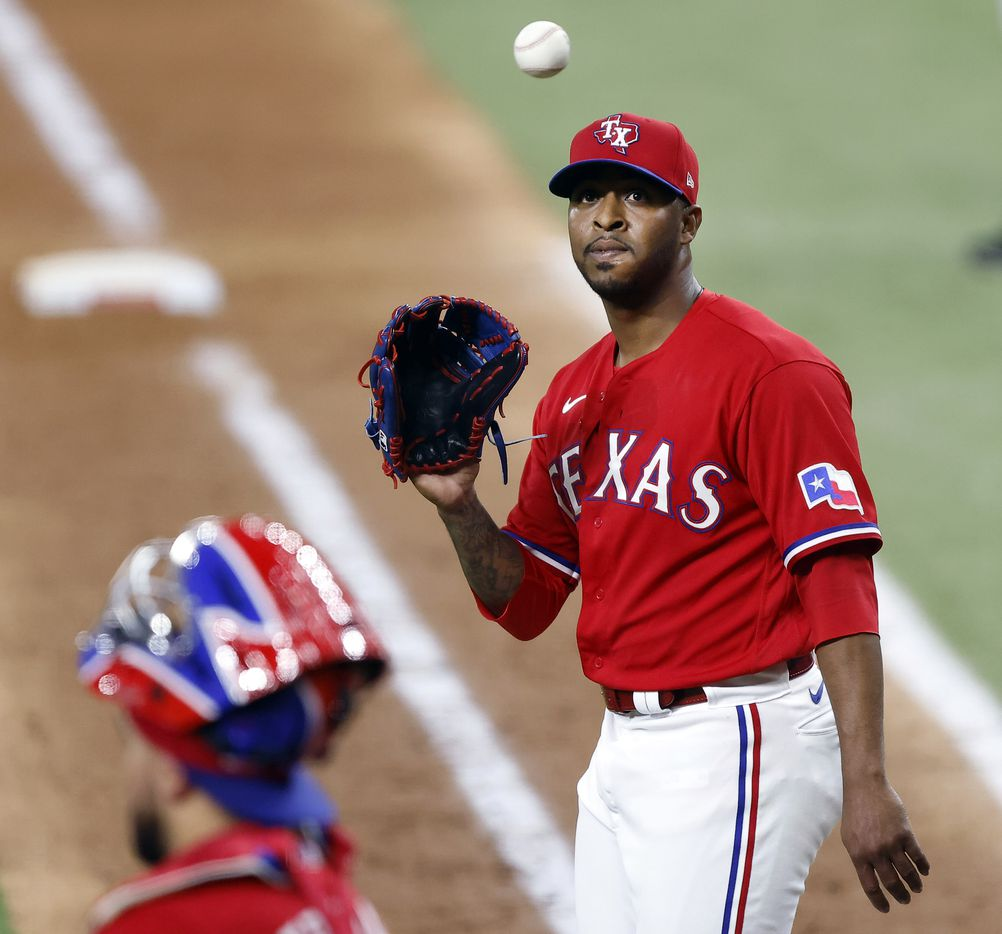 Texas Rangers relief pitcher Joely Rodriguez (57) receives the ball after giving up a run to Houston Astros Kyle Tucker in the eighth inning at Globe Life Field in Arlington, Texas, Friday, May 21, 2021. (Tom Fox/The Dallas Morning News)