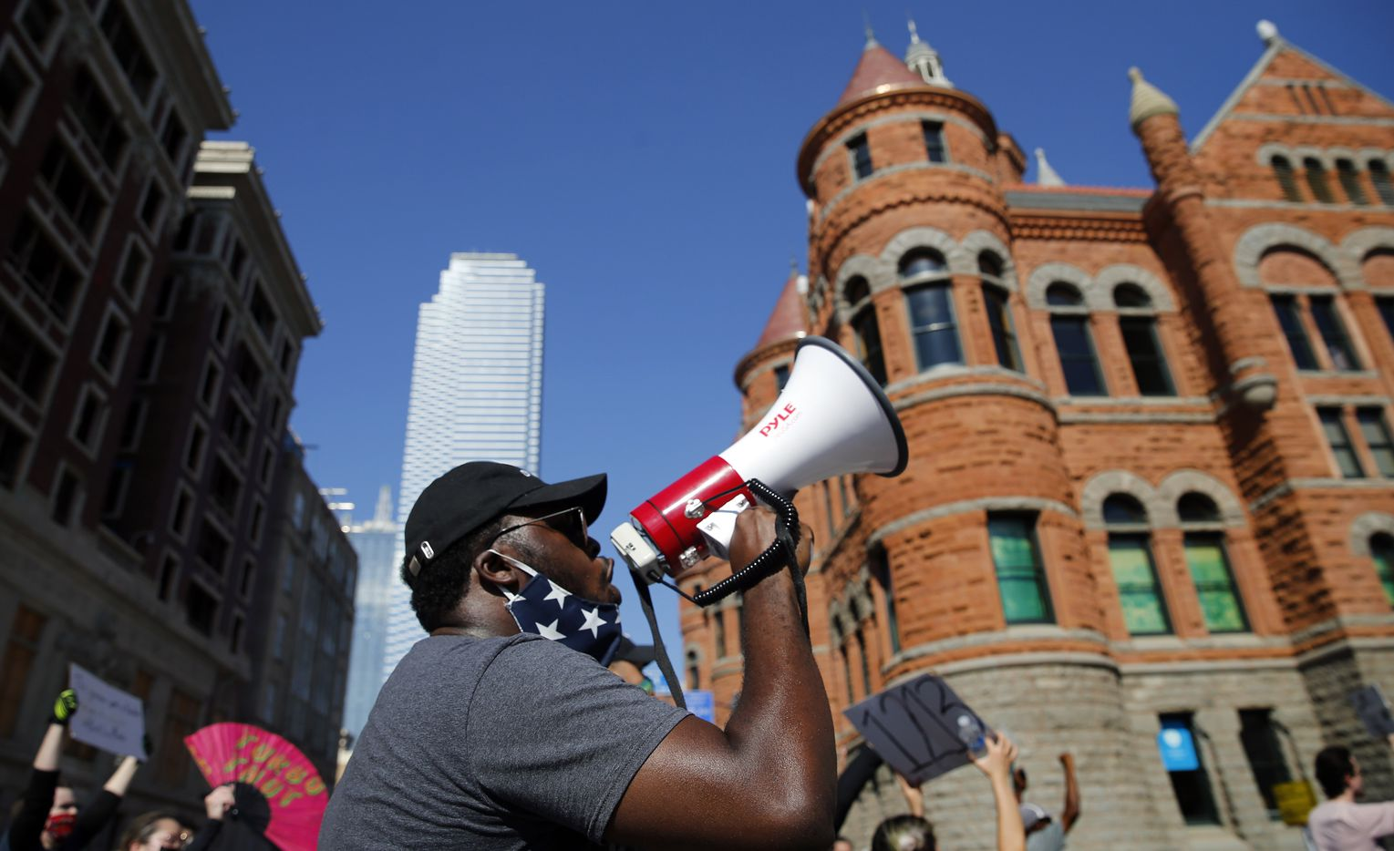 With his bullhorn, Edmund Simpson II of Dallas leads protestors in a chant as the group supporting Black Lives Matters marches back to Dallas City Hall from Dealey Plaza, Wednesday, June 3, 2020. They marched past the Old Red Courthouse in downtown. (Tom Fox/The Dallas Morning News)