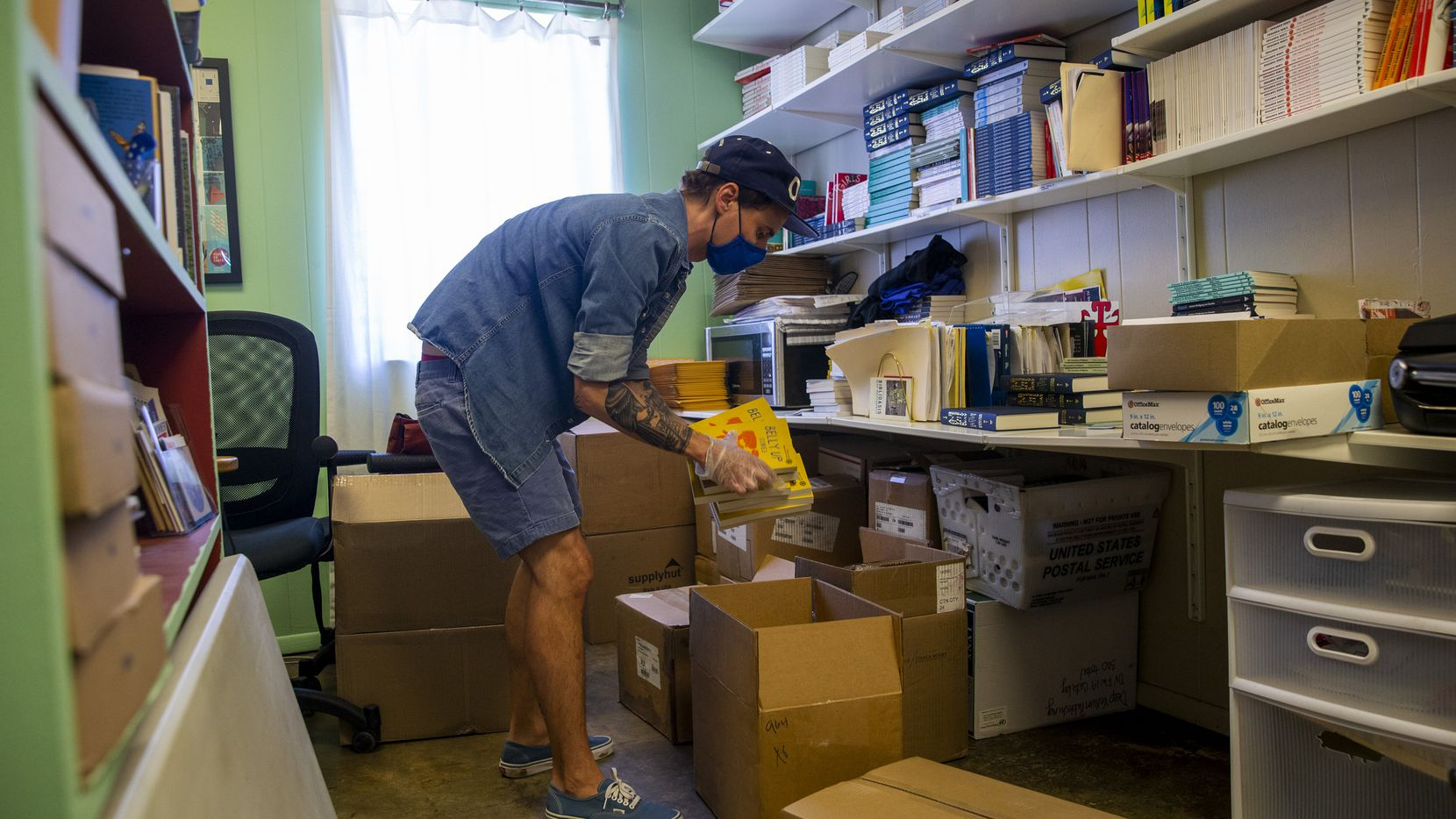 Will Evans, executive director of Deep Vellum Publishing, packages online orders for at Deep Vellum Books in Deep Ellum in Dallas on Wednesday, April 29, 2020.