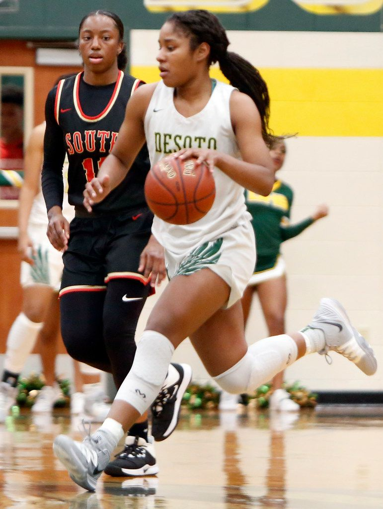 DeSoto's Ash'a Thompson (25) brings the ball down as she is guarded by South Grand Prairie's Jahcelyn Hatfield (11) during second half action. The two teams played their District 7-6A girls basketball game at DeSoto High School in DeSoto on January 21, 2020. (Steve Hamm/ Special Contributor)