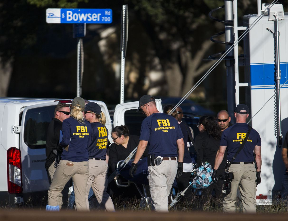 A stretcher is moved from the location where the location where the body of a young child was found on Sunday, October 22, 2017 at the corner of E Spring Valley Road and S Bowser Road in Richardson, Texas. It has not been confirmed if the body was missing three-year-old Sherin Mathews. Mathews was last seen at 3 a.m. on Saturday, October 7, 2017, when her father, Wesley Mathews told police he took her outside to stand by a tree about 100 feet from their home, as a punishment for not drinking her milk. He was arrested on a charge of abandoning or endangering a child, and was later released from custody after posting bail. (Ashley Landis/The Dallas Morning News)