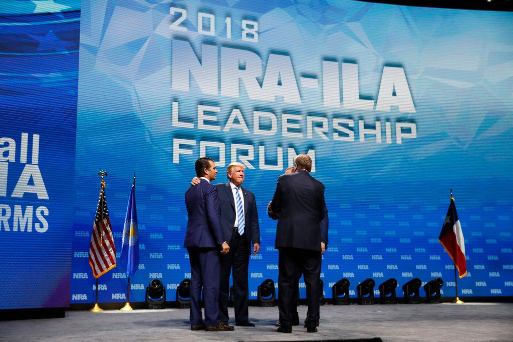 President Donald Trump greets his son Don Trump Jr before speaking to the crowd assembled in the Kay Bailey Hutchison Convention Center for the NRA Annual Meeting in Dallas, Friday, May 4, 2018. . This is the second year as President that Trump has spoken to the gun rights group.