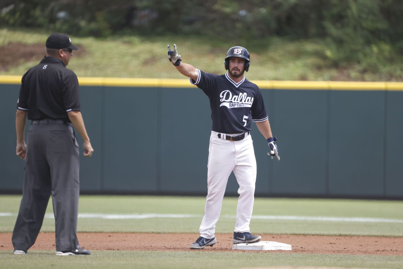 Dallas Baptist outfielder Austin Bell (5) reacts after hitting a double against Oregon St. in the first inning during the NCAA Division I Baseball Regional Championship game in Fort Worth, Texas on June 7, 2021. (Ron Jenkins/Special Contributor)