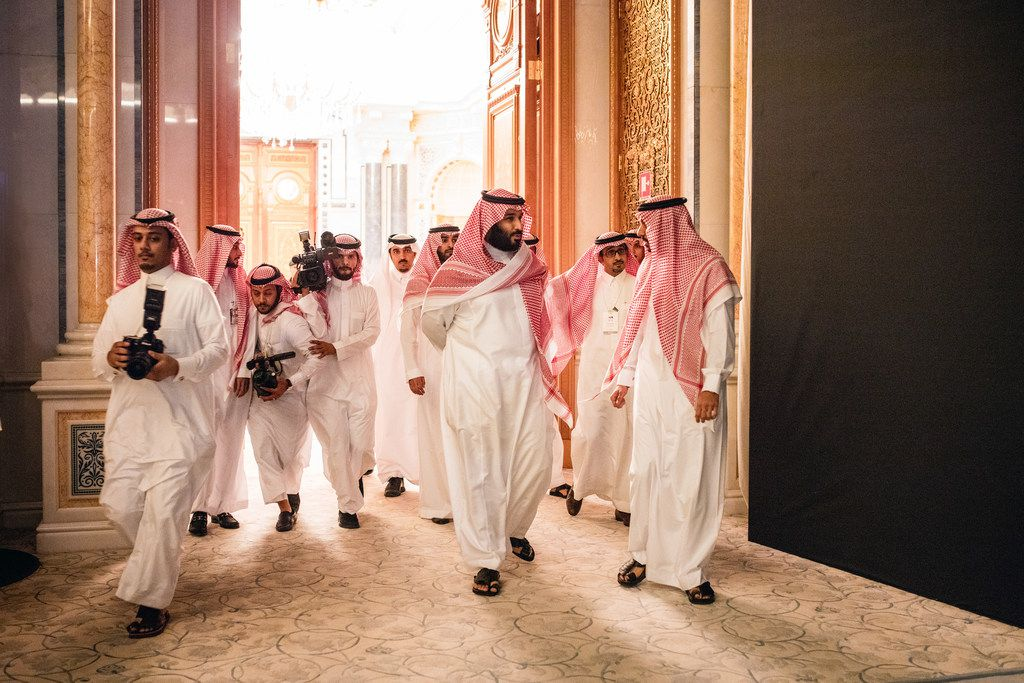 Trailed by his entourage, Crown Prince Mohammed bin Salman (center) arrived at a financial conference in Riyadh, Saudi Arabia, in October. Prince Mohammed, acting though a friend and distant cousin, was the true buyer behind the purchase of Leonardo da Vinci's Salvator Mundi for a record-breaking $450.3 million.