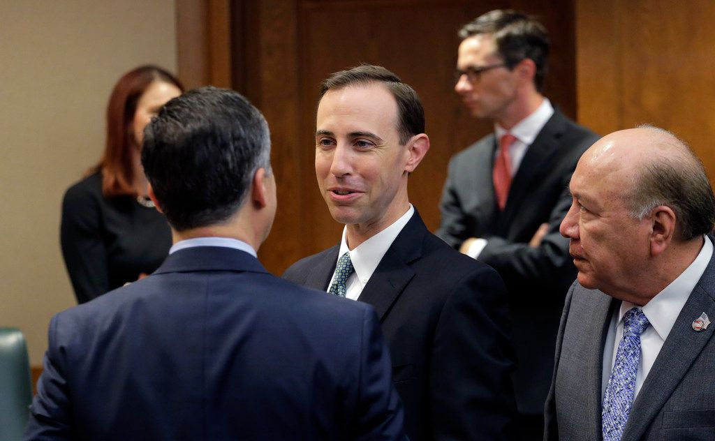 Secretary of State David Whitley, center, arrives for his confirmation hearing, Thursday, Feb. 7, 2019, in Austin, Texas, where he addressed the backlash surrounding Texas' efforts to find noncitizen voters on voter rolls.  (AP Photo/Eric Gay)