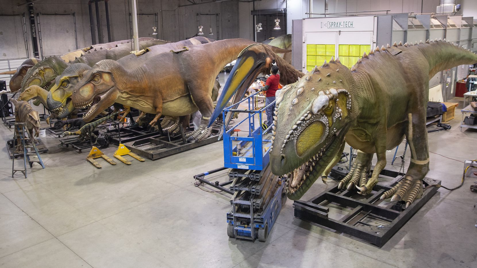 Employees prepared dinosaurs at Billings Productions, an animatronic dinosaur company in Allen, on Feb. 11, 2020.