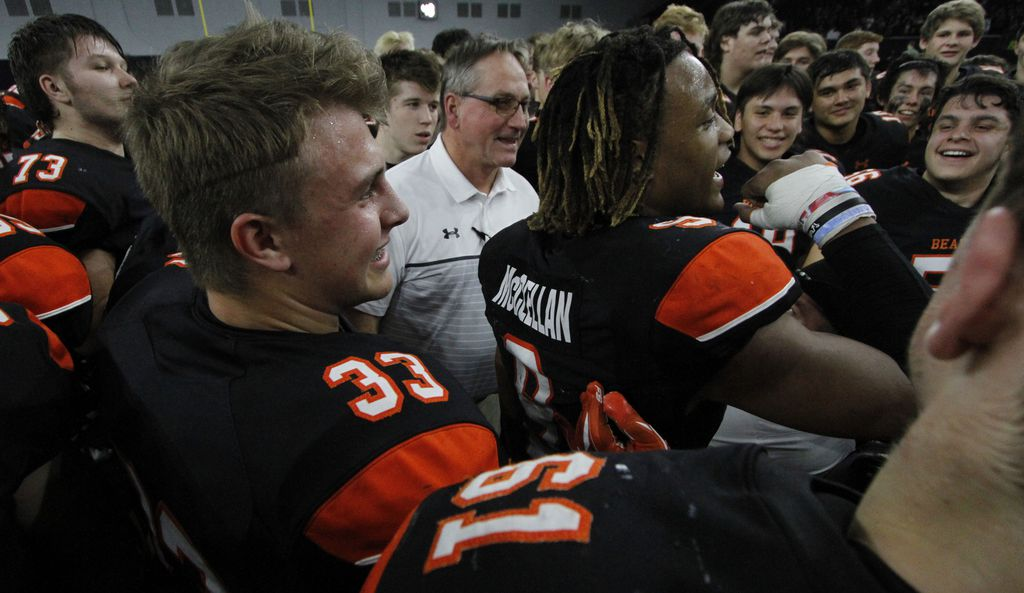 Aledo head coach Tim Buchanan, center, celebrates as running back Jase McClellan (9) leads a cheer at midfield following the Bearcats 43-36 overtime victory over Ennis to advance.  The two teams played their Class 5A Division ll Regional final playoff football game at Frisco Center at The Star in Frisco on December 6, 2019. (Steve Hamm/ Special Contributor)