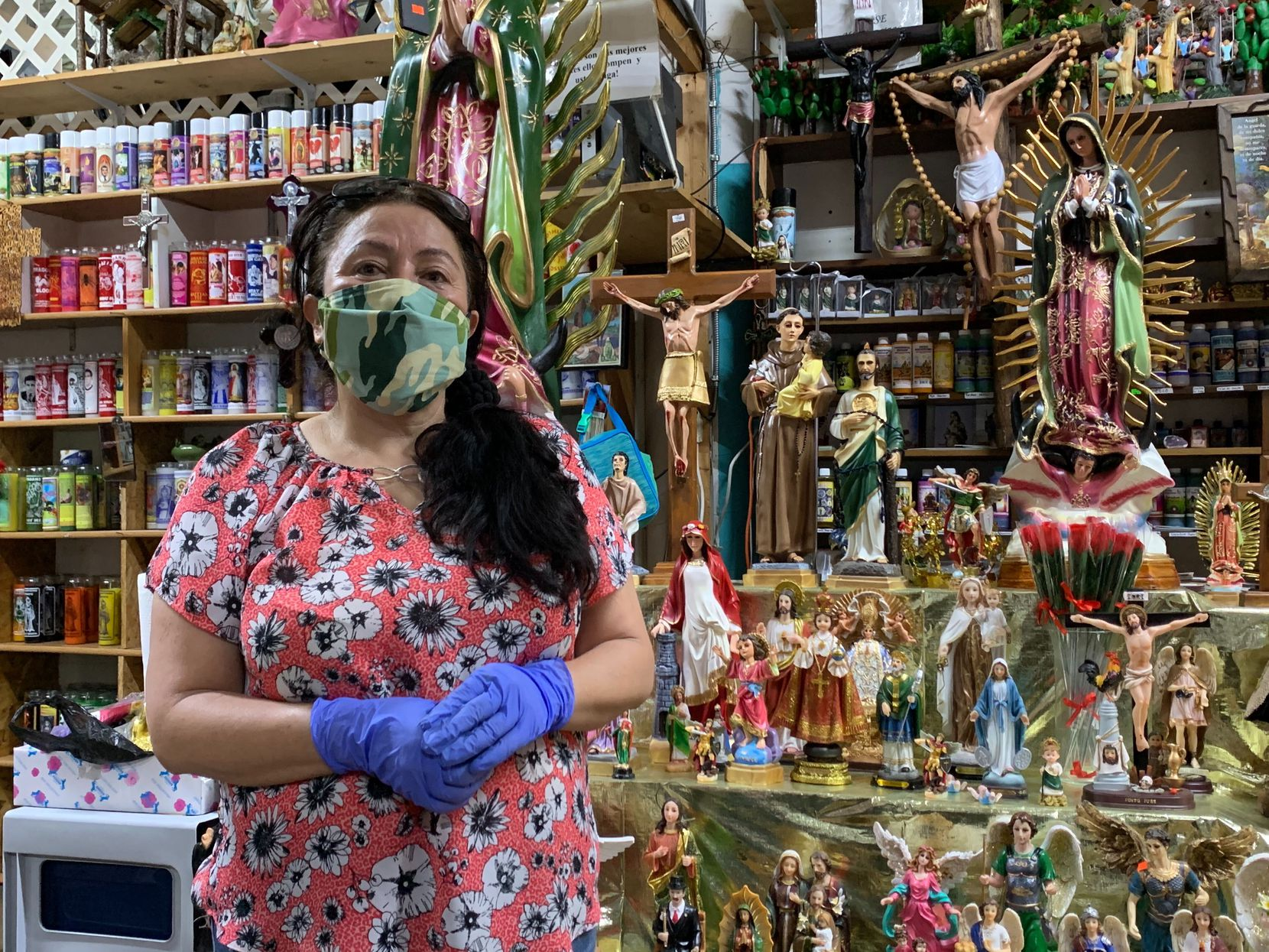 Maribel Marure, who works in northwest Dallas selling religious figurines and candles at her shop, poses for a photo Friday.