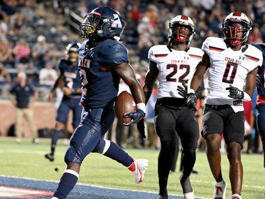 Allen's Jaylen Jenkins (2) runs in front of Cedar Hill's Kylan Salter (22) and Cedar Hill's Keandre Jackson (0) for a touchdown in the first half of a high school football game between Cedar Hill and Allen, Friday, Sept. 10, 2021, in Allen, Texas.
