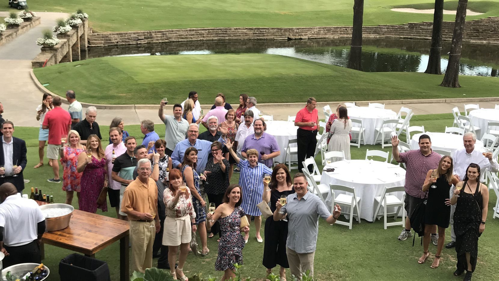 Billingsley Co. workers gathered for a party on a golf course. The family-owned company specializes in master-planned developments and principles of new urbanism.