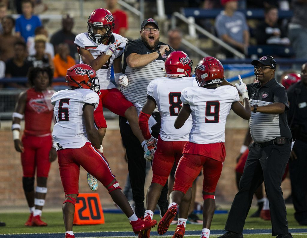Cedar Hill cornerback Jalon Peoples (19) celebrates after an interception in the end zone during the second quarter of a high school football game between Allen and Cedar Hill on Friday, August 30, 2019 at Eagle Stadium in Allen. (Ashley Landis/The Dallas Morning News)