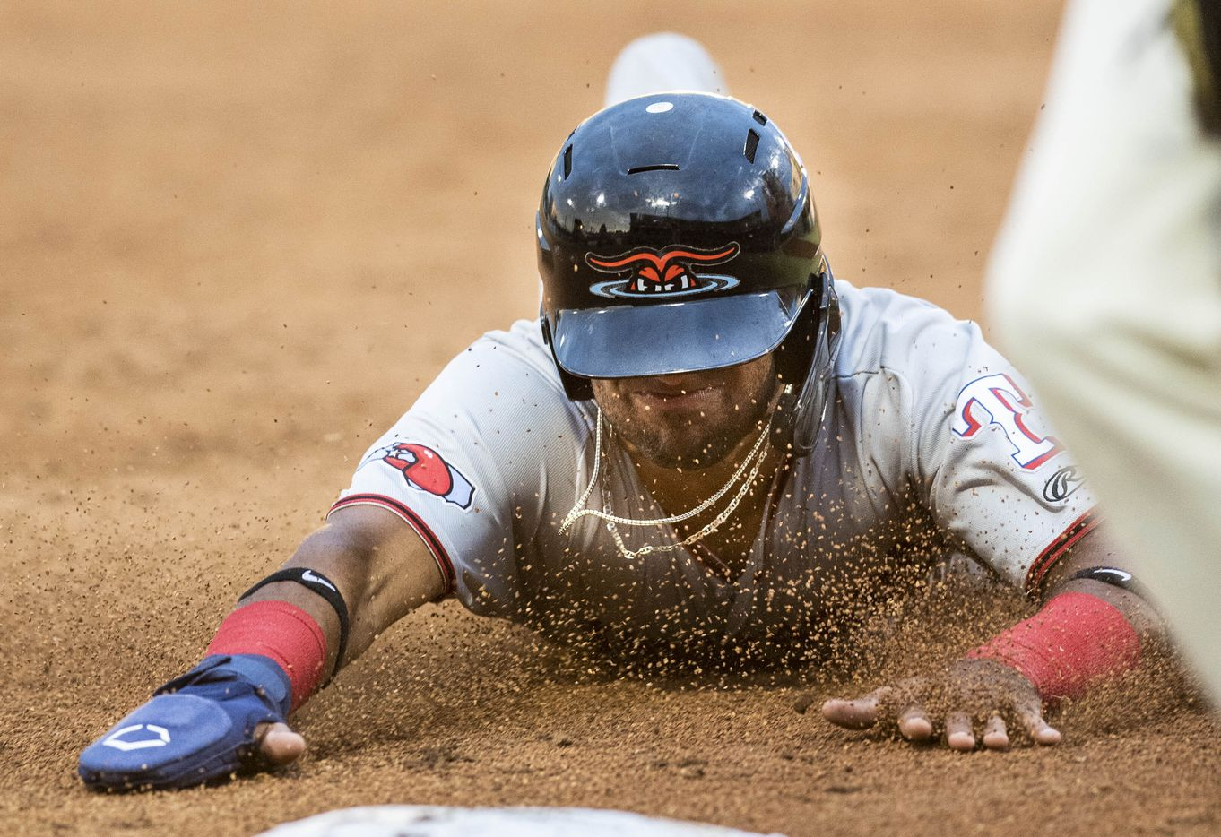 Hickory Crawdad's Ezequiel Duran (17) slides into third base on a hit and run during the game with the Greensboro Grasshopper's at First National Bank Field on Friday, August 6, 2021 in Greensboro, N.C. (Woody Marshall/Special Contributor)