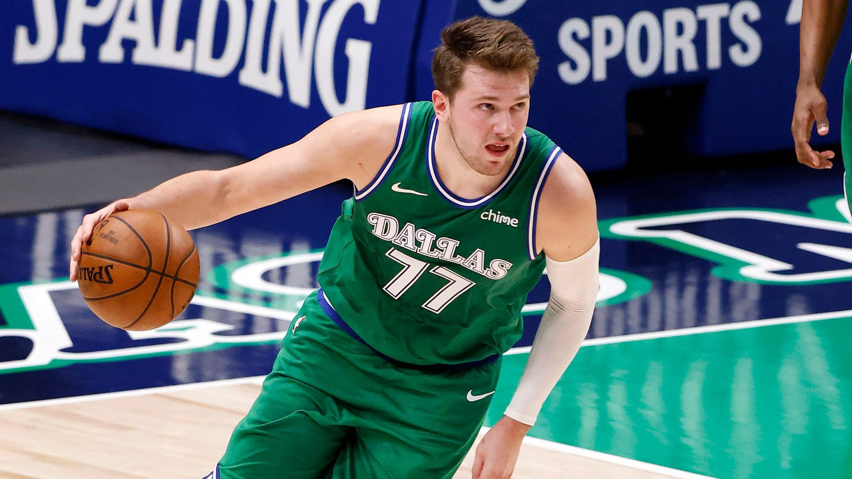 Dallas Mavericks guard Luka Doncic (77) grabs a rebound against the Milwaukee Bucks in the second quarter at the American Airlines Center in Dallas, Thursday, April 8, 2021.
