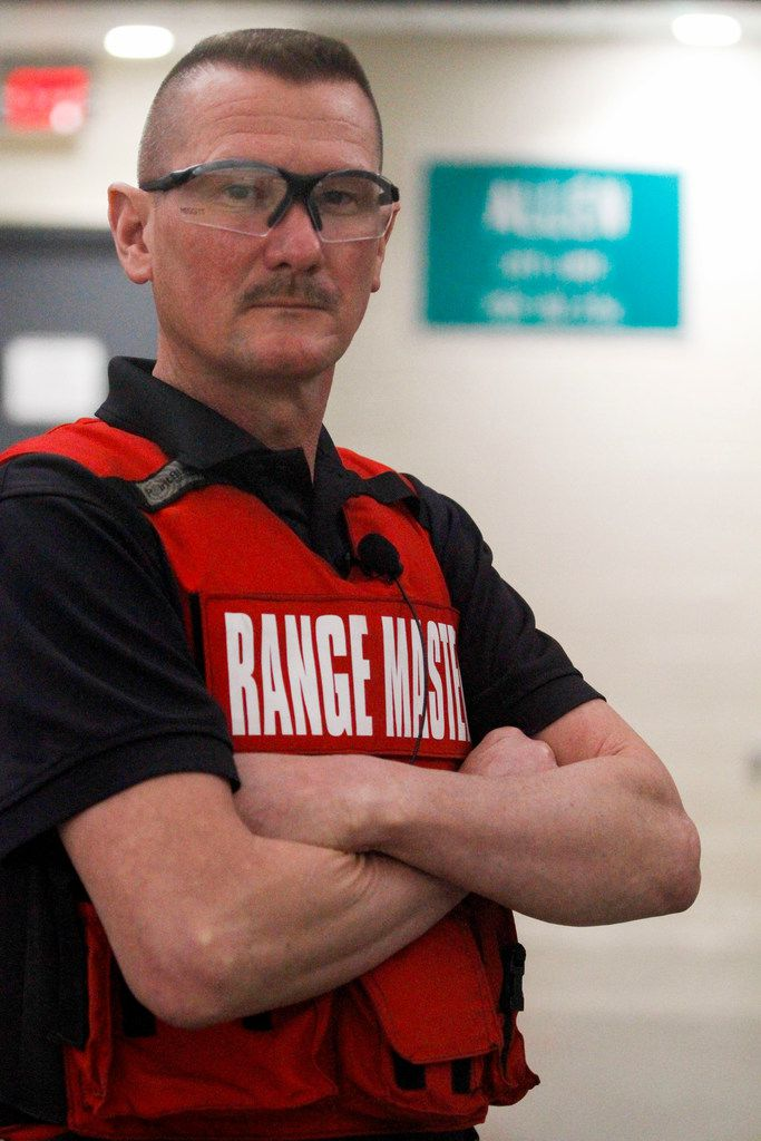 Range Master Ricky Pollan of the Allen Police Department with an Allen city-limits sign at the new Allen police gun range at the Collin College Public Training Center in McKinney.