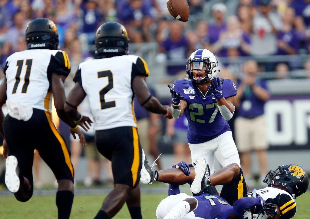 FILE - TCU safety Ar'Darius Washington (27) pulls in a first-quarter interception against Arkansas-Pine Bluff at Amon G. Carter Stadium in Fort Worth on Saturday, Aug. 31, 2019.