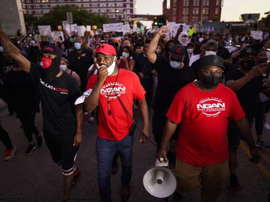 Dominique Alexander, the head of Next Generation Action Network, leads a march against police brutality at the Dallas Police Headquarters on Friday, May 29, 2020, in Dallas.
