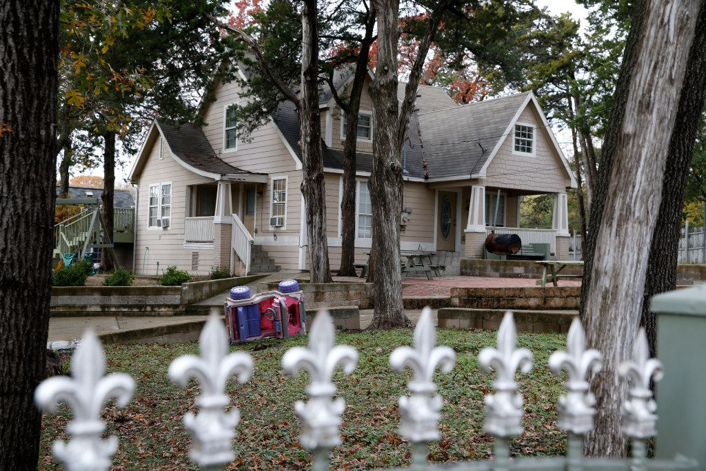A Coria Corp. home in southern Dallas, guarded by a fleur-de-lis fence.