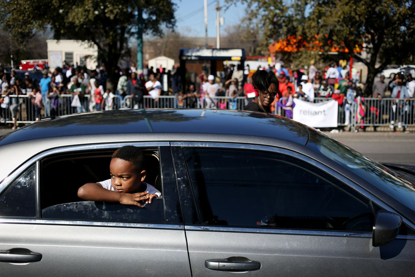 King Walton, 6, watches from a car while participating in the parade.