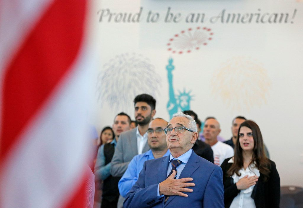 Jorge Lloveras of Cuba recited the pledge of allegiance during a naturalization ceremony last year at the U.S. Customs and Immigration Services headquarters in Irving.