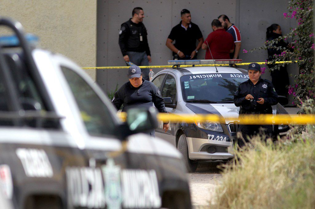 Ministerial agents are seen outside a criminal hideout where eight people with signs of torture were found alive along with four dead ones, in Tlajomulco de Zuniga, Jalisco State, Mexico, on May 3, 2019.