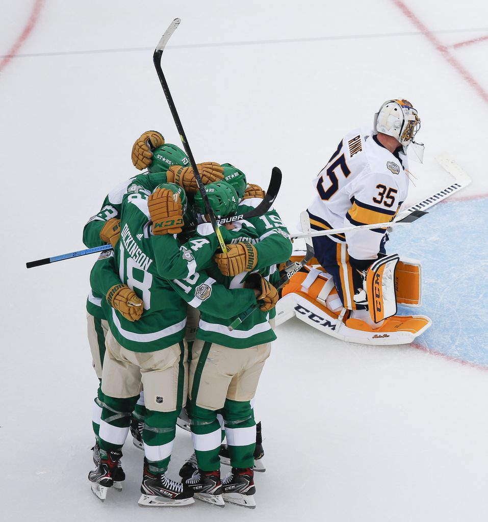 The Dallas Stars celebrate after Dallas Stars left wing Blake Comeau (15) scored a goal on Nashville Predators goaltender Pekka Rinne (35) during the second period of a NHL Winter Classic matchup between the Dallas Stars and the Nashville Predators on Wednesday, January 1, 2020 at Cotton Bowl Stadium in Dallas. (Ryan Michalesko/The Dallas Morning News)