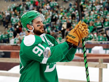 Dallas Stars center Tyler Seguin (91) applauds the crowd for their support after playing the Nashville Predators in the NHL Winter Classic hockey game at the Cotton Bowl in Dallas, Wednesday, January 1, 2020.