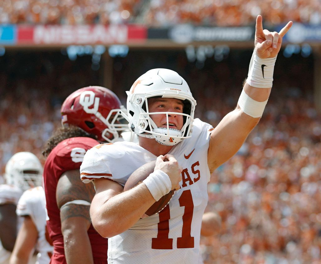 Texas Longhorns quarterback Sam Ehlinger (11) celebrates after rushing for a touchdown in a game against Oklahoma Sooners during the second half of play at the Cotton Bowl in Dallas on Saturday, October 6, 2018. Texas Longhorns defeated Oklahoma Sooners 48-45. (Vernon Bryant/The Dallas Morning News)