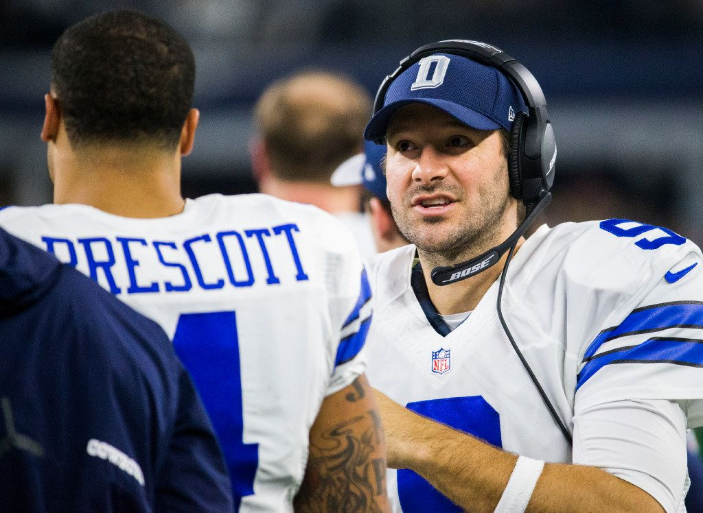 Dallas Cowboys quarterback Dak Prescott (4) talks with quarterback Tony Romo (9) on the sideline during the third quarter of their game against the Tampa Bay Buccaneers on Sunday, December 18, 2016 on at AT&T Stadium in Arlington, Texas. (Ashley Landis/The Dallas Morning News)