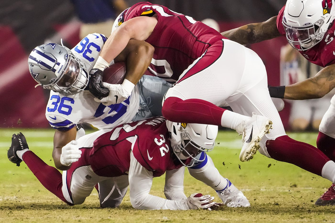 Dallas Cowboys running back Brenden Knox (36) is brought down by Arizona Cardinals linebacker Evan Weaver (50) and cornerback Tay Gowan (32) during the second half of a preseason NFL football game at State Farm Stadium on Friday, Aug. 13, 2021, in Glendale, Ariz.