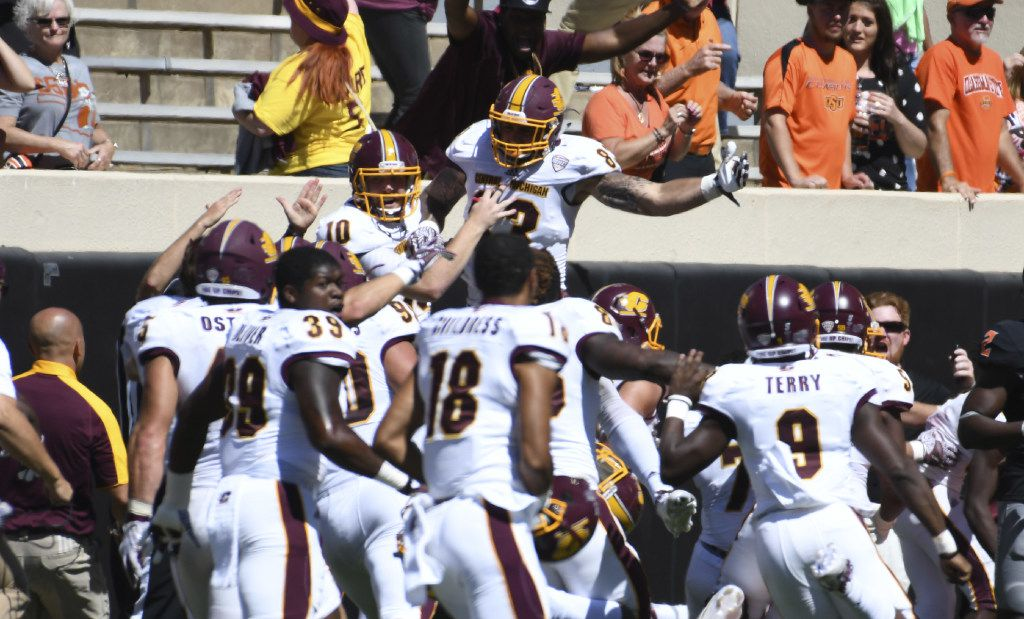 STILL WATER, OK - SEPTEMBER 10: Quarterback Cooper Rush #10 of the Central Michigan Chippewas and tight end Tyler Conklin #83 of the Central Michigan Chippewas celebrate after a NCAA football game, September 10, 2016 at Boone Pickens Stadium in Stillwater, Oklahoma. Central Michigan won 30-27 on the last play of the game.  (Photo by J Pat Carter/Getty Images)
