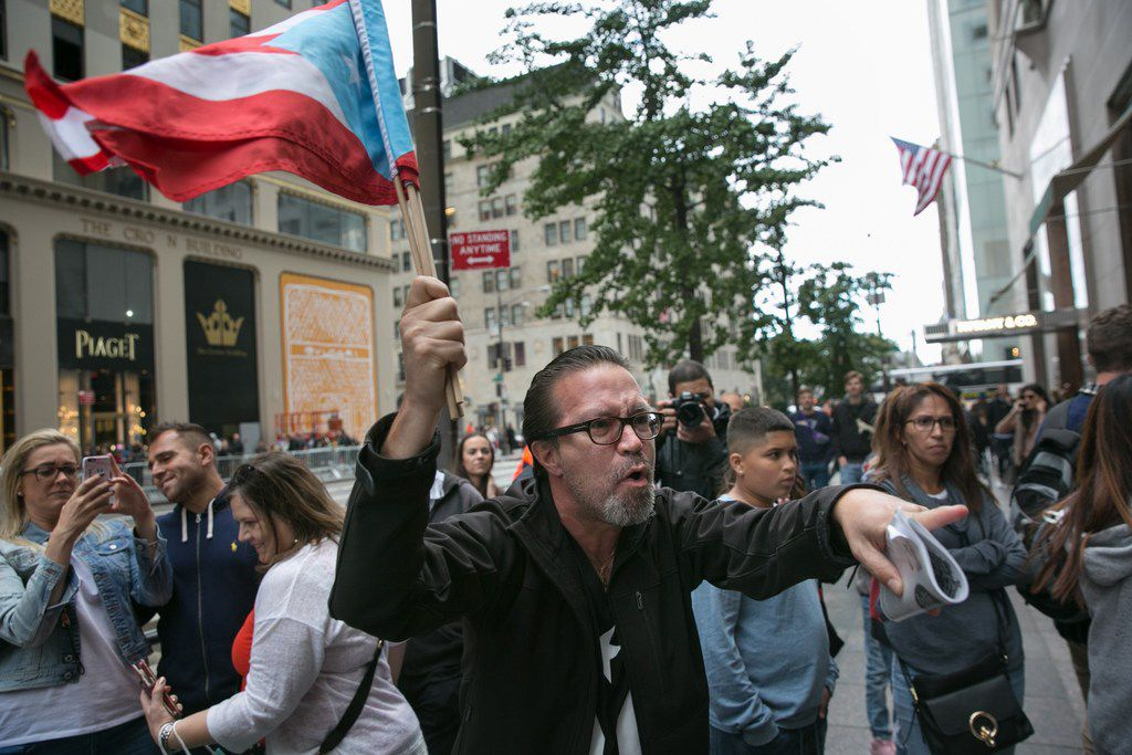 David Galarza confronts Trump supporters in front of Trump Tower on September 30, 2017 in New York City.