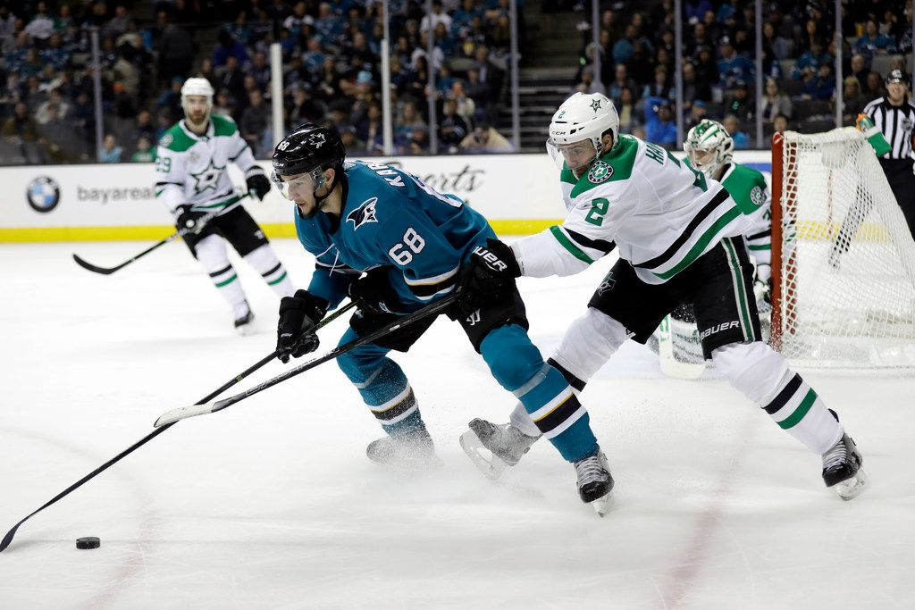 San Jose Sharks' Melker Karlsson (68) is defended by Dallas Stars' Dan Hamhuis (2) during the second period of an NHL hockey game Sunday, Feb. 18, 2018, in San Jose, Calif. (AP Photo/Marcio Jose Sanchez)