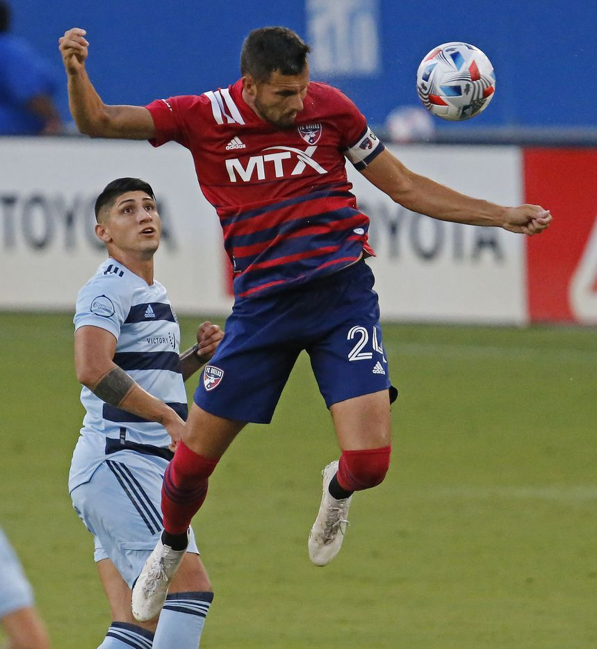 FC Dallas defender Matt Hedges (24) heads the soccer ball during the first half as FC Dallas hosted Sporting Kansas City at Toyota Stadium in Frisco on Saturday evening, August 14, 2021. (Stewart F. House/Special Contributor)