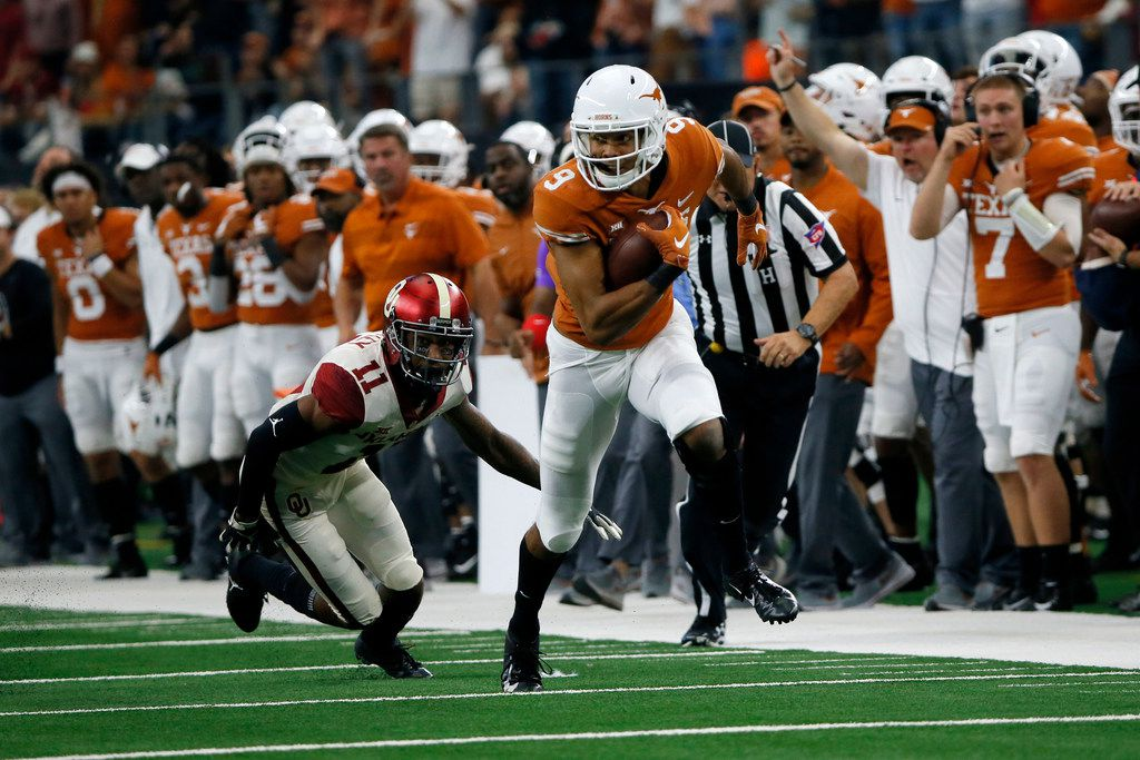 Texas Longhorns wide receiver Collin Johnson (9) advances the ball while Oklahoma Sooners cornerback Parnell Motley (11) attempts a tackle during the first half of the NCAA Big 12 Conference football championship, Saturday, Dec. 1, 2018, in Arlington, Texas. Oklahoma defeated Texas 39-27. (AP Photo/Roger Steinman)