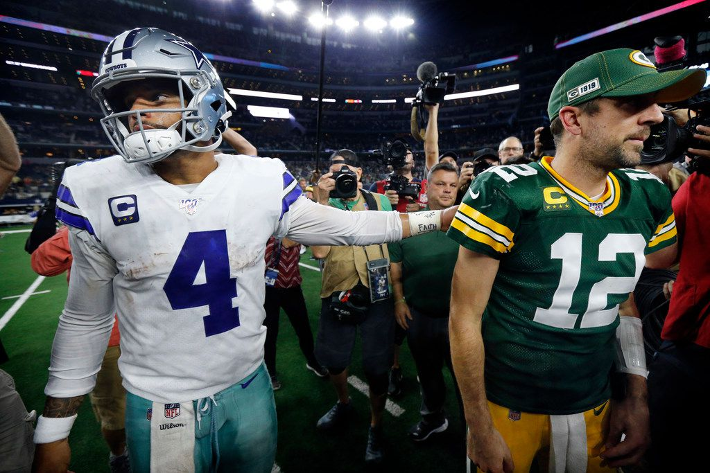 Cowboys quarterback Dak Prescott (4) congratulates Packers quarterback Aaron Rodgers (12) after Dallas' 34-24 loss at AT&T Stadium in Arlington on Sunday, Oct. 6, 2019.